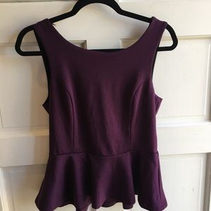 Purple peplum top with open bow back